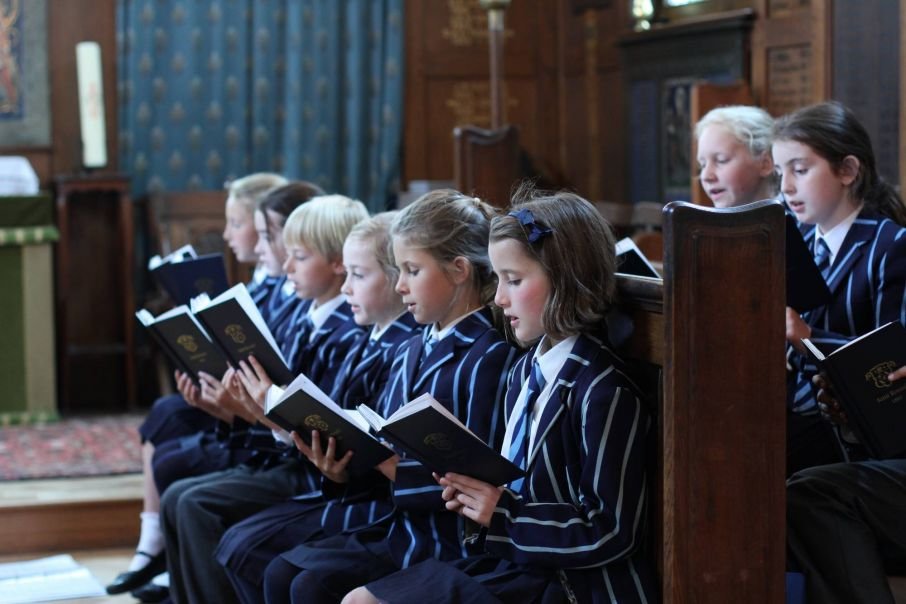 School children with hymn books and music