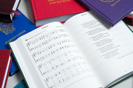 Bespoke hymn books with one book open at Harvest page