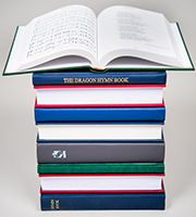 Stack of bespoke hymn books showing top book open