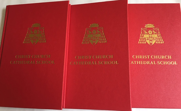 Christ Church Cathedral School hymn book covers in a row